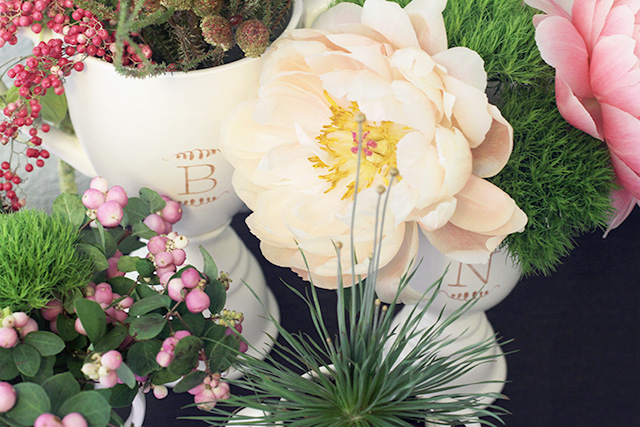 Monogrammed Trophies Filled with Flowers