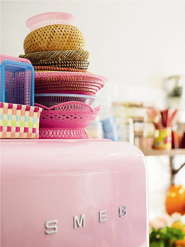 Mismatched Baskets on Top of a Pink Fridge