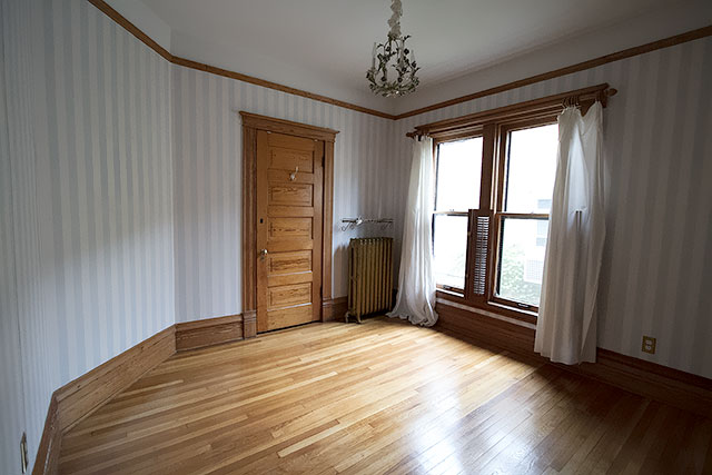 Bedroom with Blue Striped Wallpaper