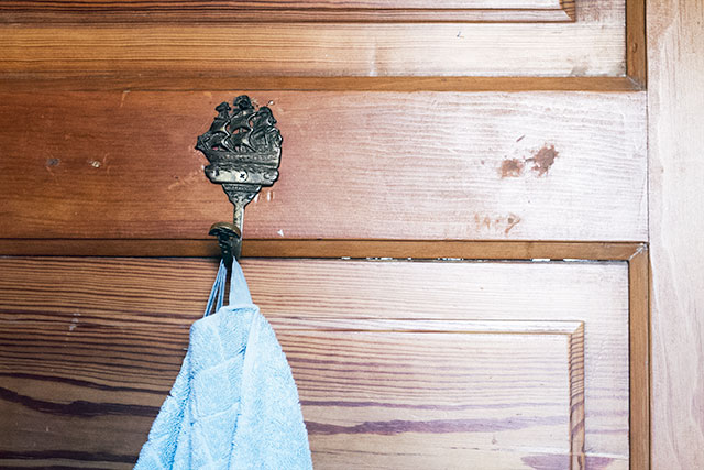 Blue Towels and Brass Sailing Ship Hook