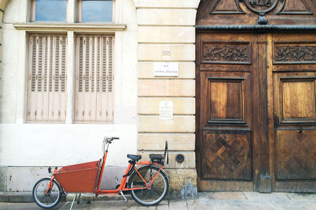 A Cute Orange Bicycle in Dijon, France