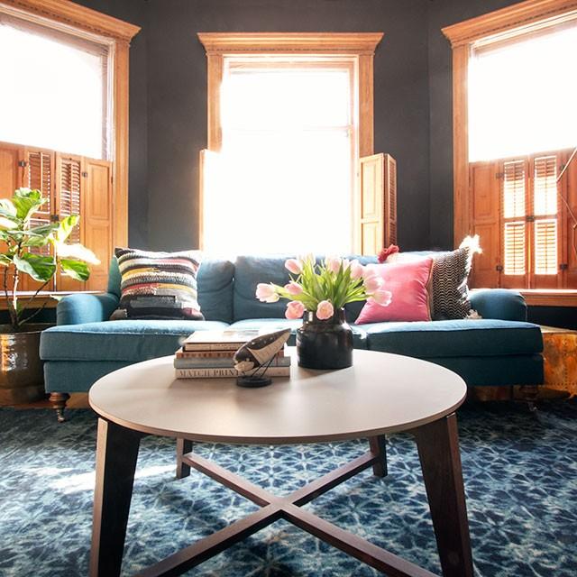 Teal Sofa, Black Walls, Blue Loloi Rug | Making it Lovely