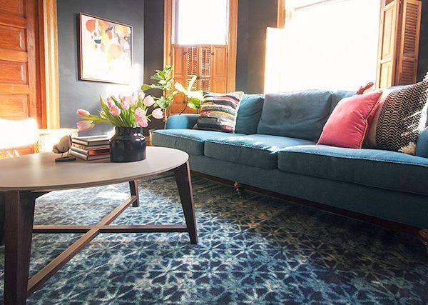Teal Sofa, Black Walls, Blue Loloi Rug   Making it Lovely