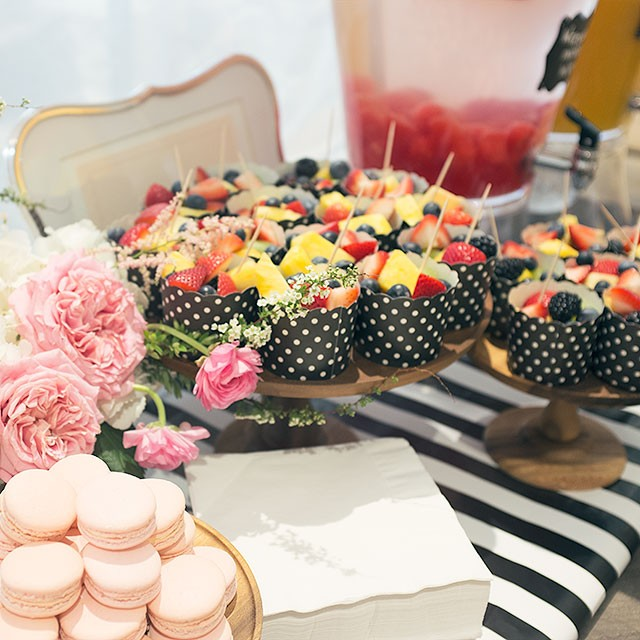 Pink Macarons, Fruit, Watermelon-Infused Water, and Mimosas