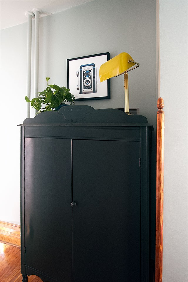 Armoire as Linen Storage in the Hallway, with Art Above