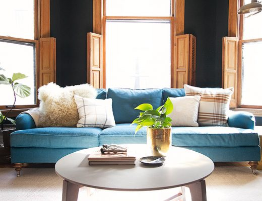 Teal Sofa with Plaid Pillows | Making it Lovely