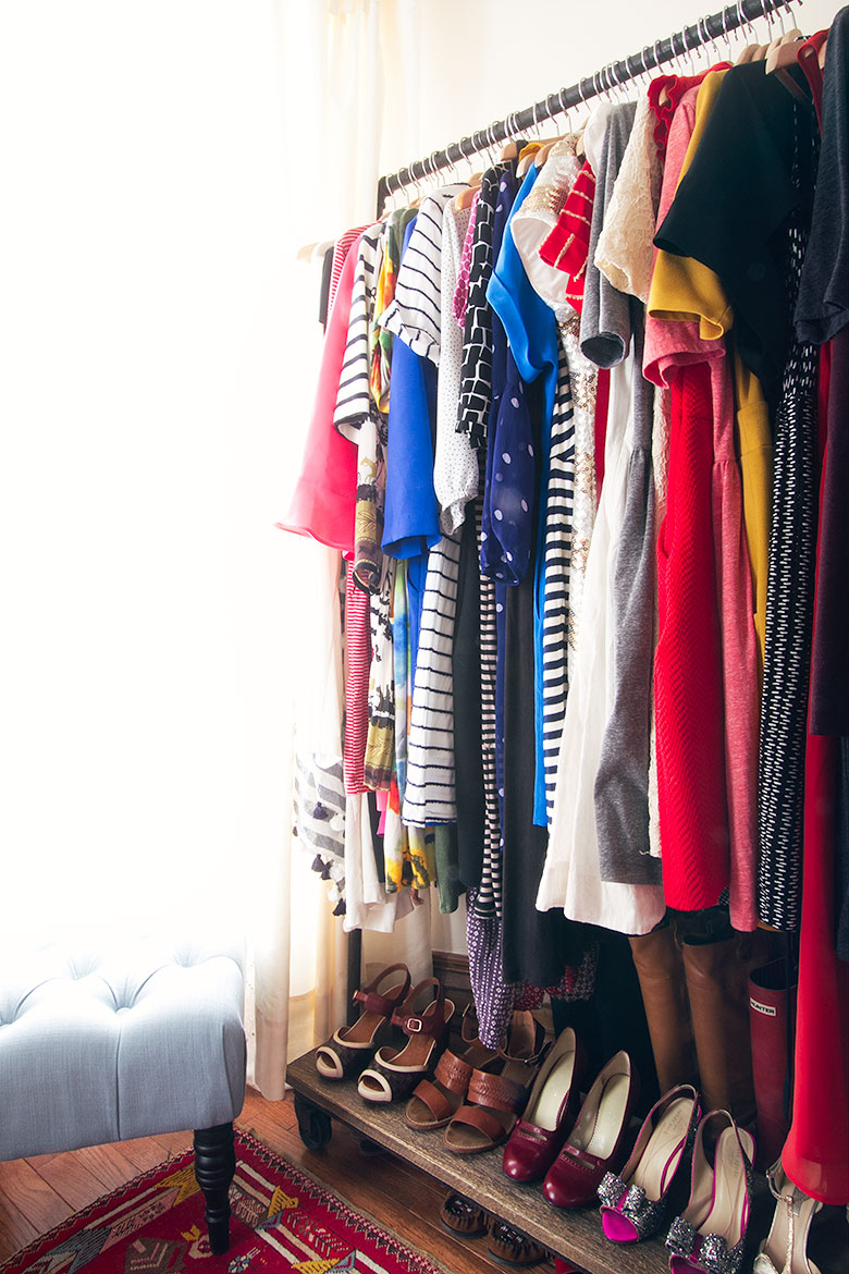 Dresses Hanging on an Industrial Garment Rack, Shoes Below | Making it Lovely's Closet