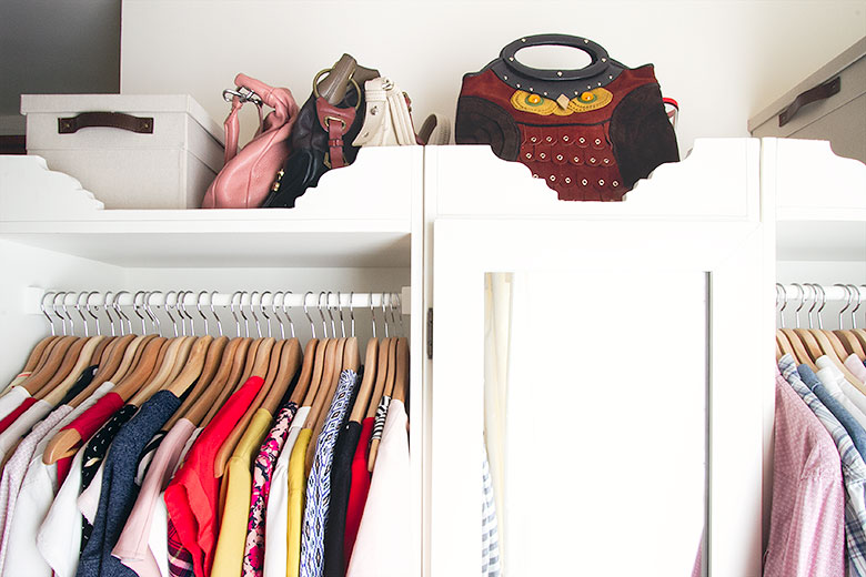 Purses Above the Closet's Hanging Storage