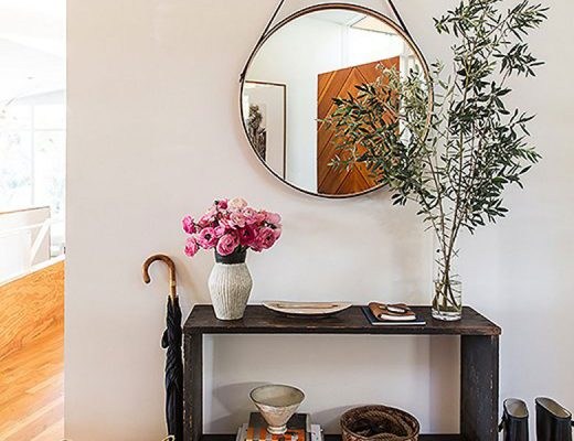 Leather Strap Mirror Above an Antique Table