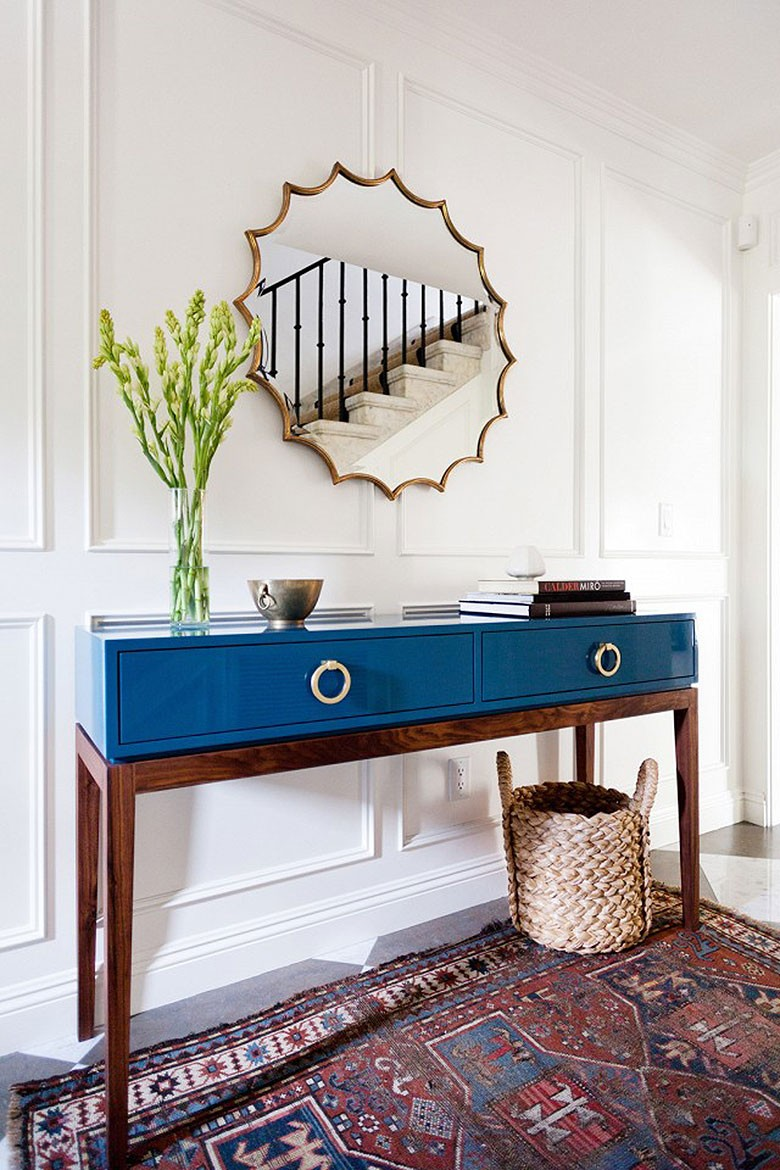 Choosing a console table and mirror for an entryway making it lovely turquoise blue lacquered console table in an entryway geotapseo Gallery