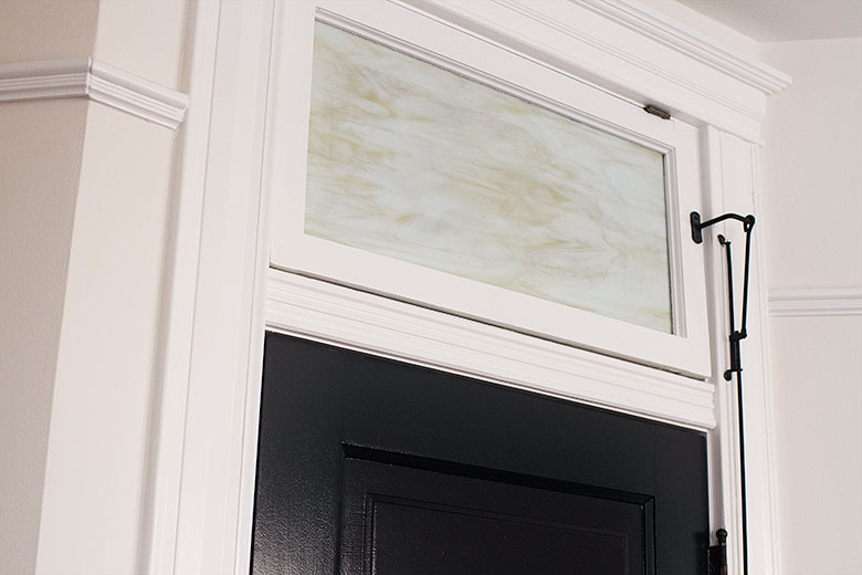 White Trim and Transom Window, Black Door