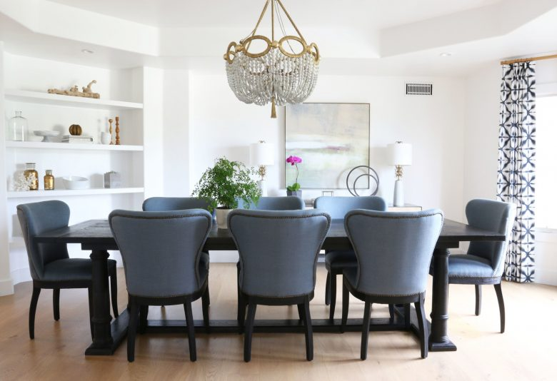 dining room with blue restoration hardware wingback chairs by studio mcgee