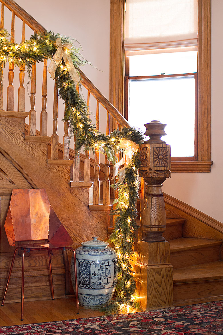 Christmas Garland on Victorian Wooden Staircase, Modern Copper Blu Dot Real Good Chair, Blue and White Pagoda Red Ginger Jar | Making it Lovely