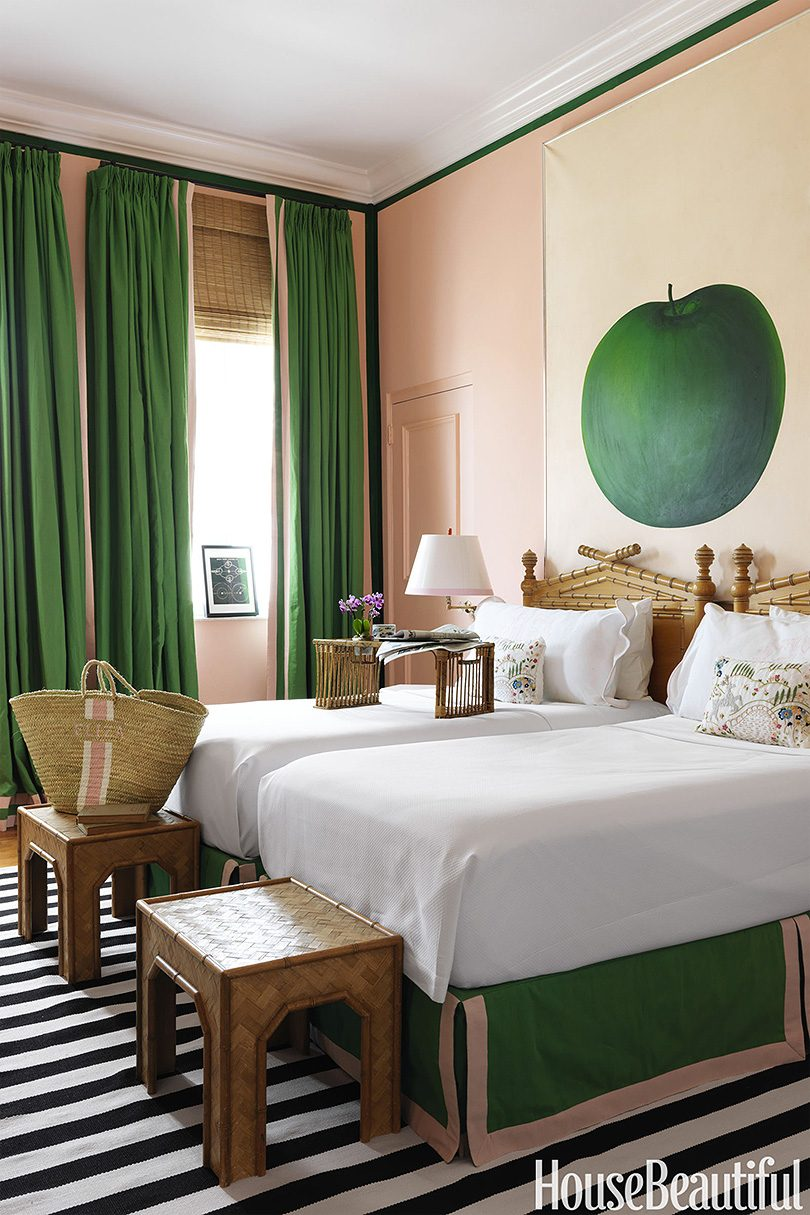 Pink and Green Bedroom with Striped Rug