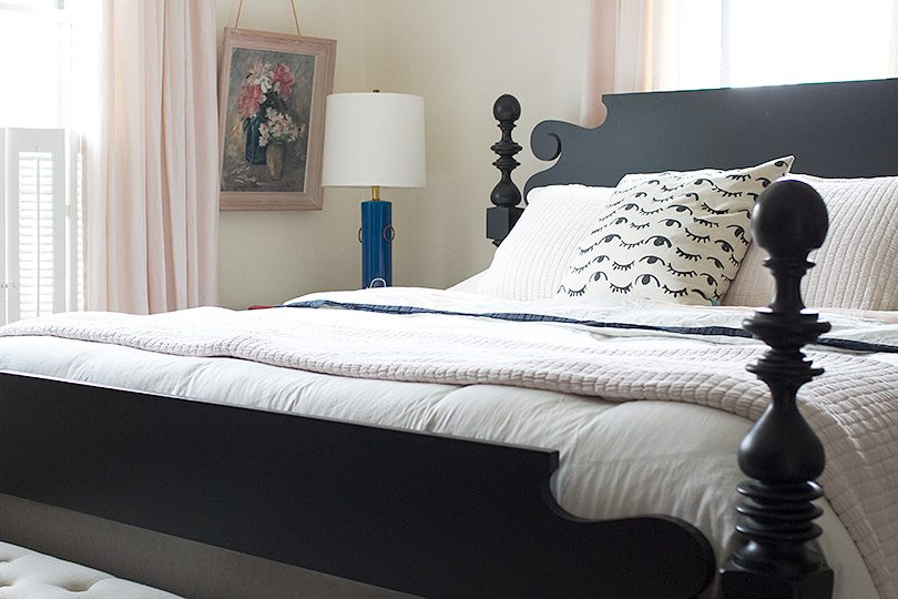 Black Wooden Bed, White and Pink Bedding