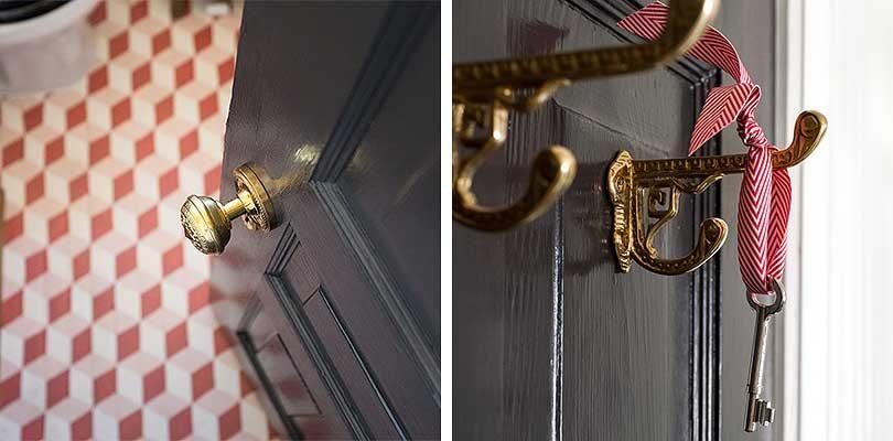 Bathroom with Brass Hardware on a Black Door