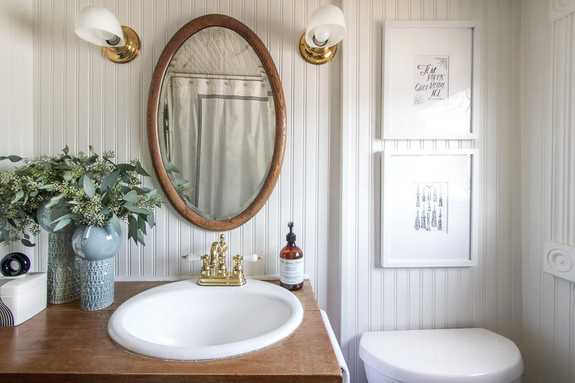 Bathroom with Antique Oval Mirror, Dresser Turned Sink | Making it Lovely