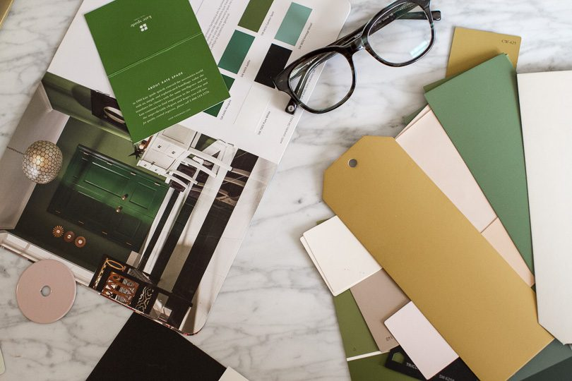 green, pale pink, and ochre yellow paint swatches