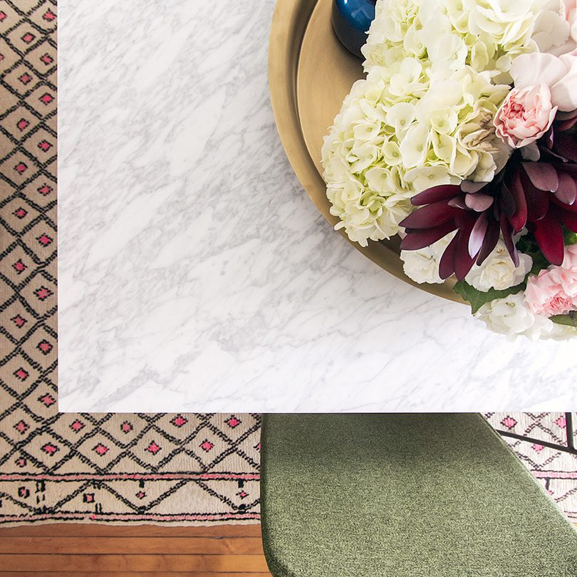 Marble Dining Table, Moroccan Rug, Flowers on a Brass Tray, Green Dining Chairs