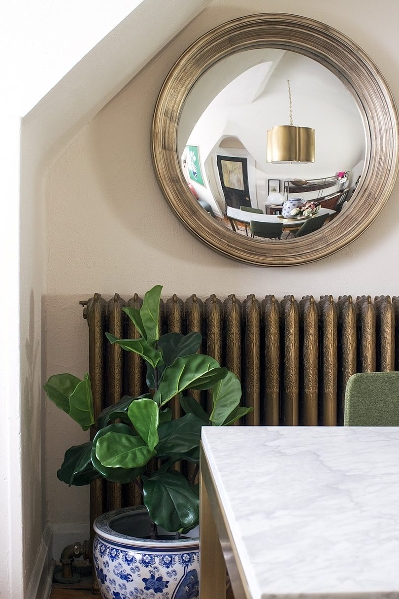 Fiddle Leaf Fig in Blue and White Planter, Brass Cast Iron Radiator, Convex Mirror