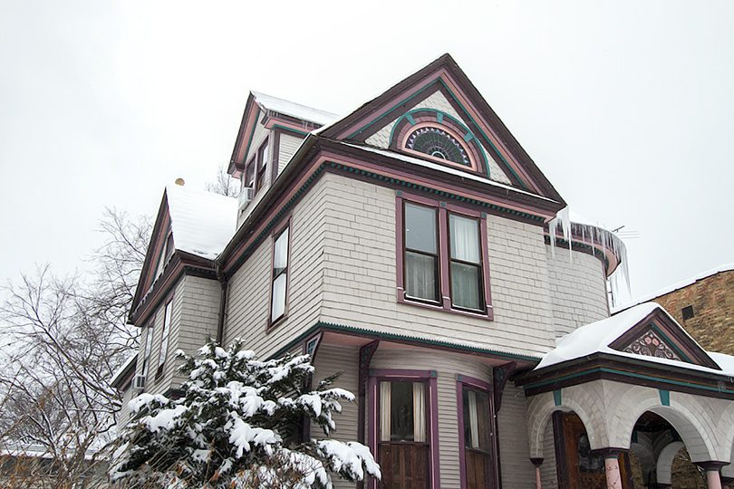Our Victorian Queen Anne Home in the Winter with Icicles and Snow