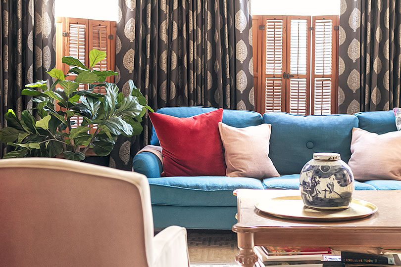 Teal Sofa in Front of Custom Curtains from The Shade Store | Making it Lovely