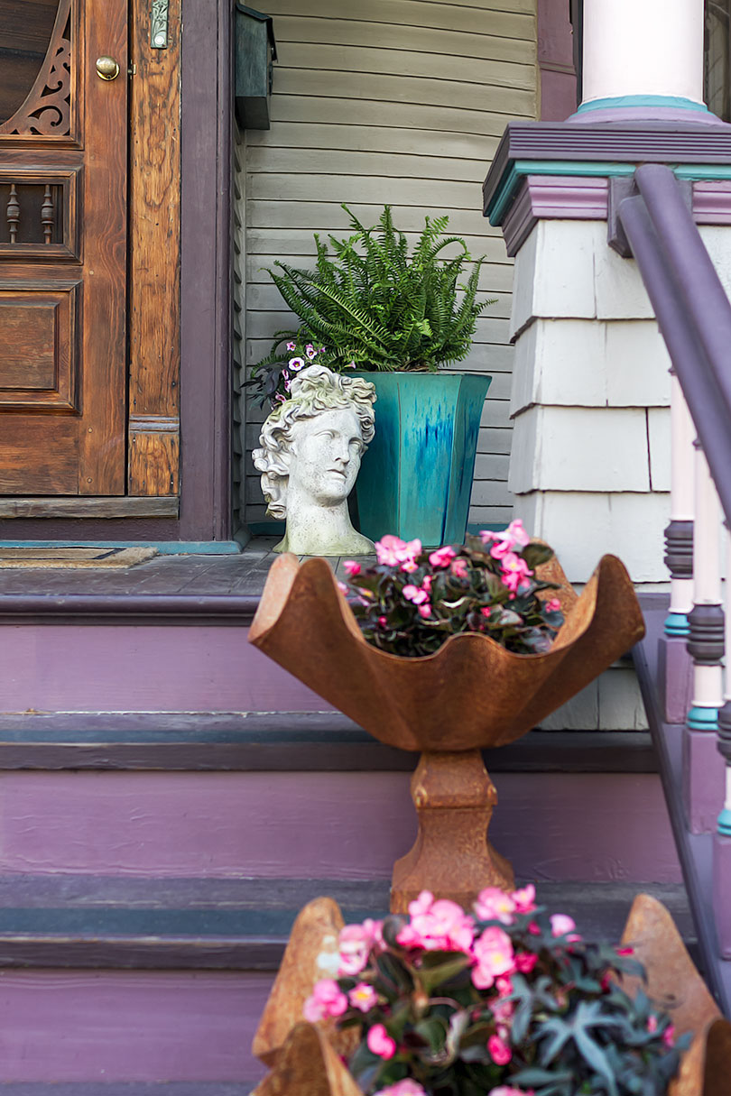 Victorian Front Porch with Curved and Apollo Bust Planters | Making it Lovely