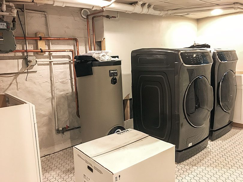 Laundry Room Cabinets, Washer, and Dryer, Plus Hot Water