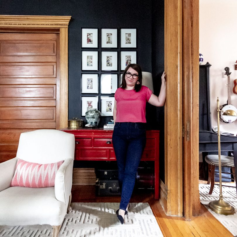 Nicole of Making it Lovely, Black Living Room with Framed Grid of Tarot Card Art