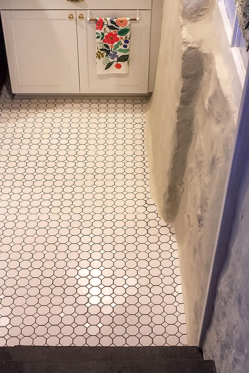 Floor Tile Along Stone Foundation Wall