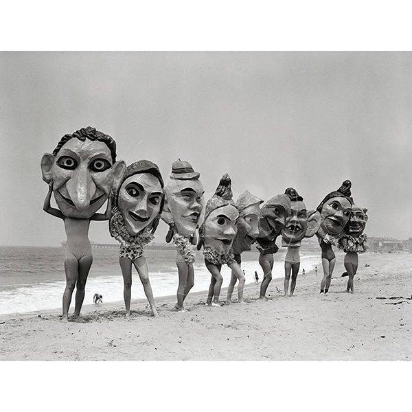 Women Holding Giant Masks, Bettmann Photo