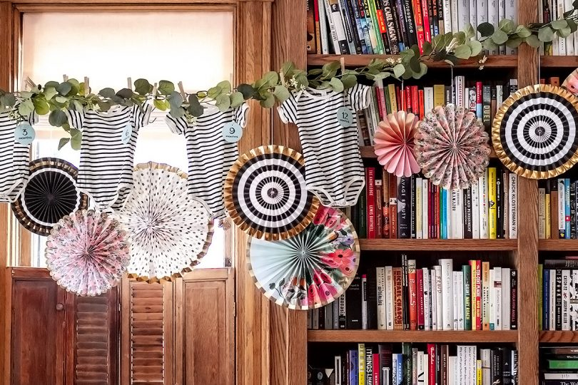 Baby Shower Decorations — Onesies and Colorful Paper Party Fans | Making it Lovely