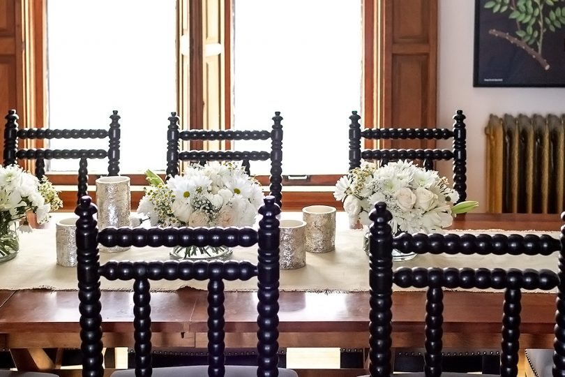 Dining Room Table with White Flowers